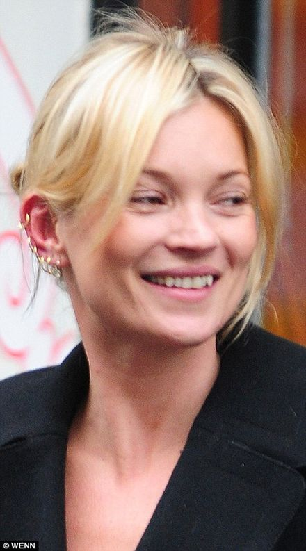 Lord of the rings kate moss shows off six piercings after for Kate moss tattoo