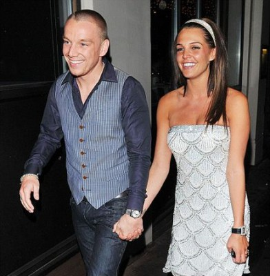 WAG Danielle enjoys some passion off the pitch as she  shares a kiss with her third Spurs player