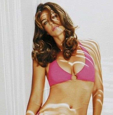 Liz Hurley covers up as she cuts the ribbon at opening of first boutique for swimwear range