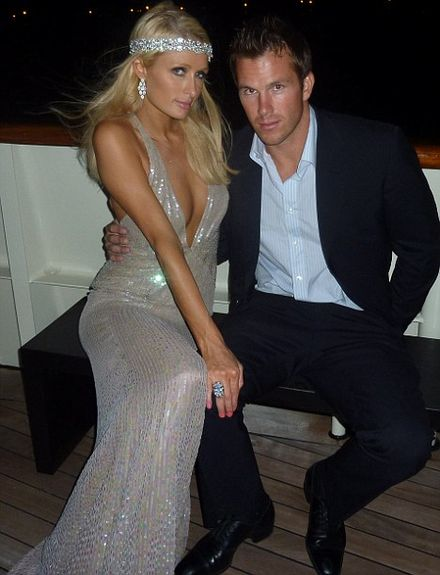 Get a room! Paris Hilton and Doug Reinhardt lock lips on the dance floor at Venice Film Festival
