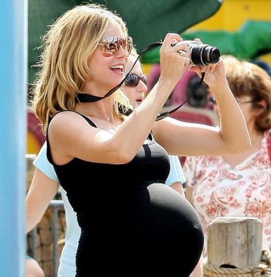 Heidi Klum\'s tum defies gravity - but the soon-to-be mum-of-four battles on with her bump