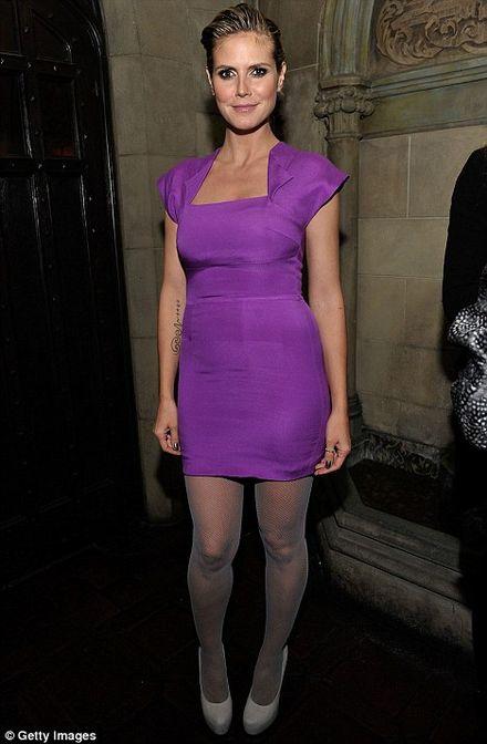 Mother-of-four Heidi Klum models her slim silhouette in hot new dress of the season