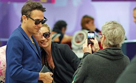Say cheese! Kate Moss and Jamie Hince take a few final holiday snaps... in Phuket Airport