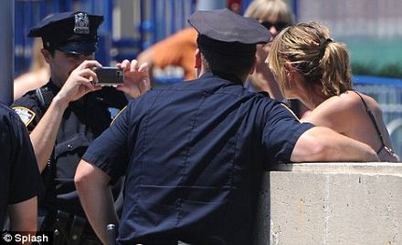 Heidi Klum makes an arresting sight as she poses for photos with police officer fans