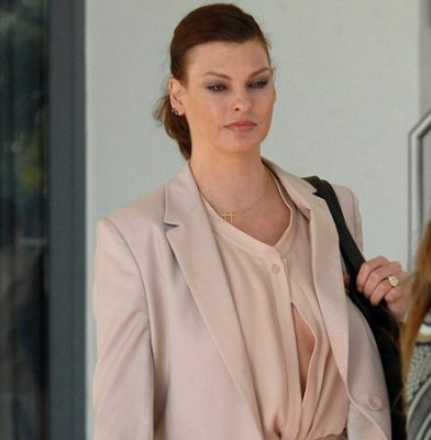 Braless Linda Evangelista suffers a wardrobe malfunction