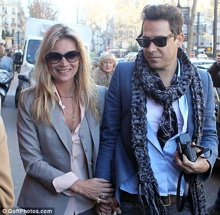Kate Moss holds tight to fianc� Jamie Hince