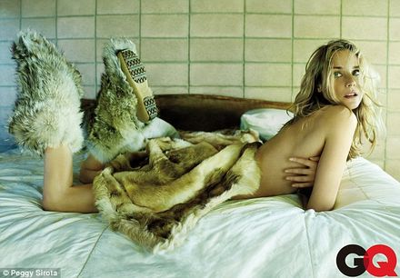 Diane Kruger rolls around in fur blanket in seductive photo shoot