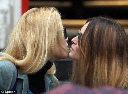 Claudia Schiffer and Elle MacPherson air kiss dropping children off at gates