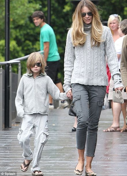 Make-up free Elle Macpherson takes her lookalike son to the Sydney Aquarium
