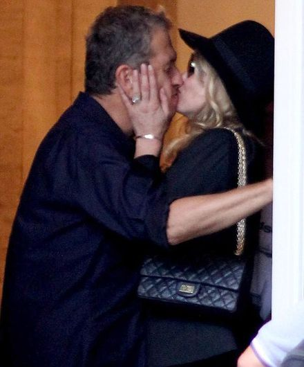 Kate Moss spied giving a goodbye kiss in Rio...