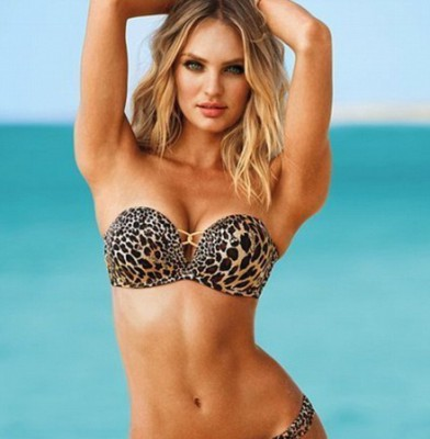 Candice Swanepoel demonstrates muscles