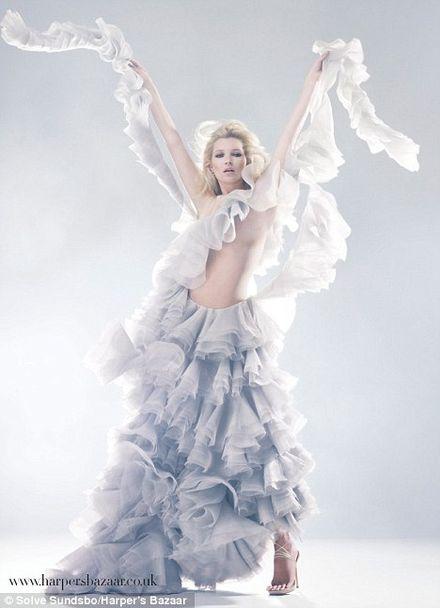 Kate Moss back in the hologram dress