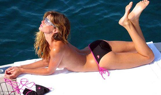 Gisele Bundchen bathes in the sun topless