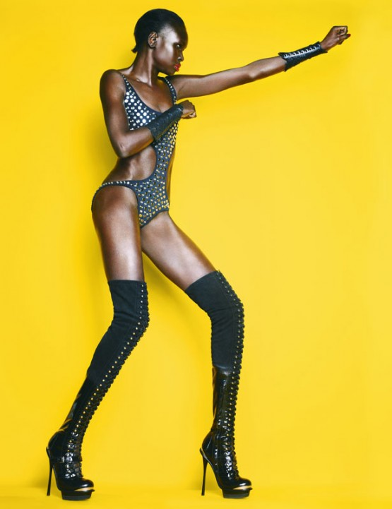 Alek Wek poses in fetish wear for Stylist Magazine