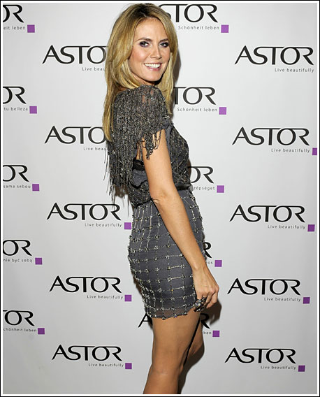 Bodypainted Heidi Klum poses for another Astor make-up campaing