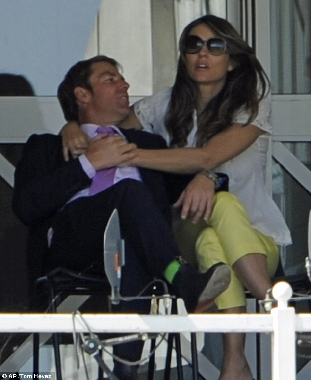 Elizabeth Hurley and Shane Warne, hot and heavy, at the cricket match