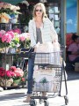 Rosie Huntington-Whiteley shows style as she stocks up on food