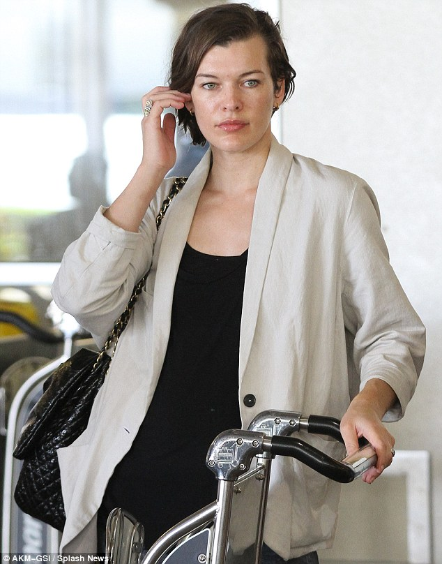 Milla Jovovich looks fabulous after long flight