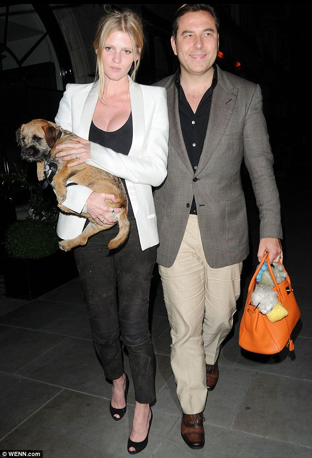 "David Walliams and Lara Stone prove, ""It´s a dog´s life."""