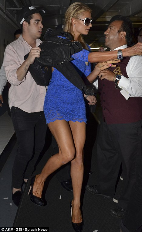 Paris Hilton takes a tumble amidst photo frenzy