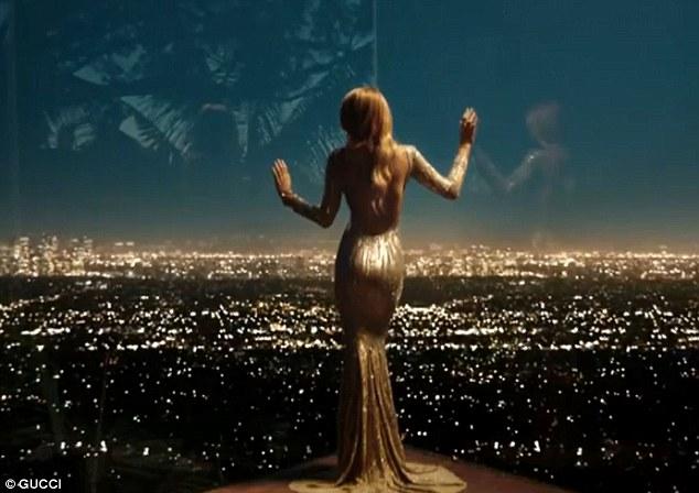 Golden girl Blake Lively shows off slender figure for new perfume ad