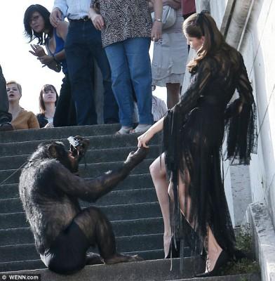 Model Laetitia Casta monkeys around with chimp on photoshoot