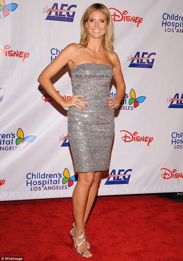 Heidi Klum shines at gala event in silver sequined dress