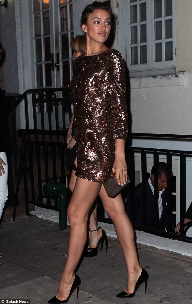 Irina Shayk sizzles in a short mini-dress for re-opening of restaurant