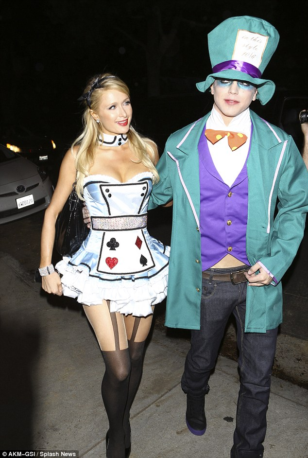 """Paris Hilton tries out the """"Alice in Wonderland"""" look a second time around for Halloween party"""
