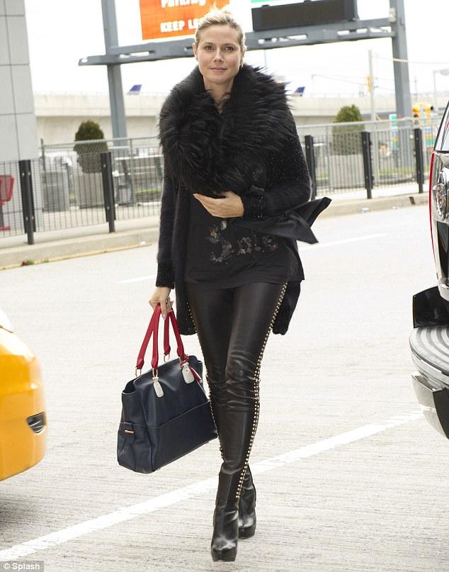Heidi Klum flies home after a one-night trip to London with bodyguard boyfriend Martin Kristen