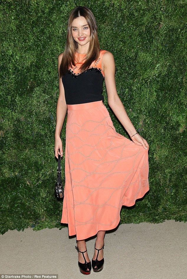Miranda Kerr wears a demure peach colored dress for CFDA and Vogue dinner