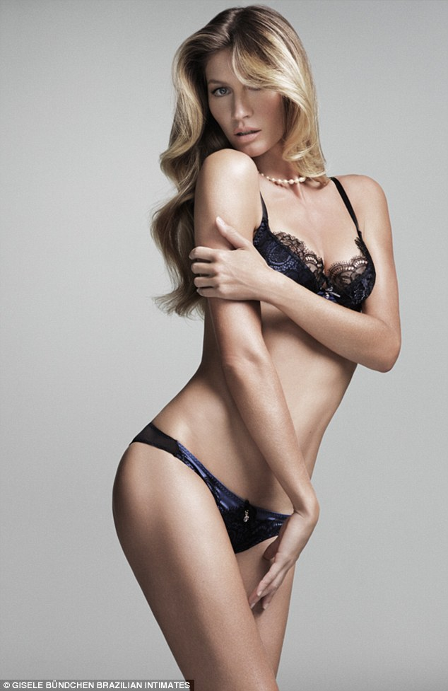 "Gisele Bundchen showcases her latest lingerie collection looking ""hot-to-trot."""