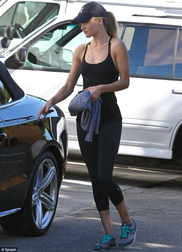 Rosie Huntington-Whiteley goes bare-faced after gym workout session