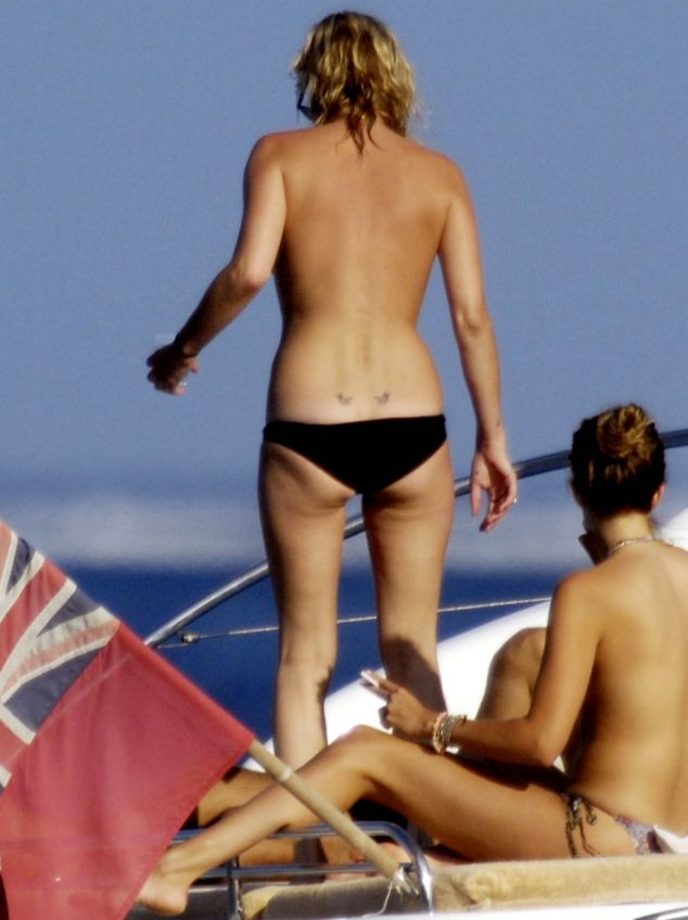 Supermodel Kate Moss goes topless in France and flaunts her Lucian Freud tattoos