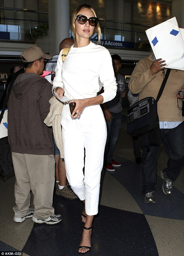 Candice Swanepoel is a dream in all-white