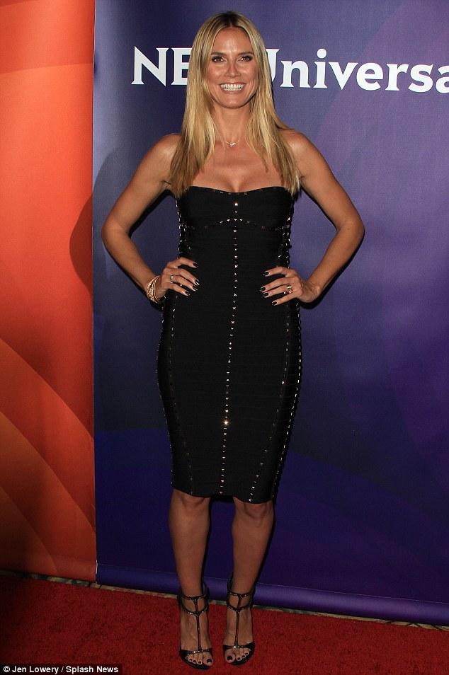 Heidi Klum sizzles in sexy black dress