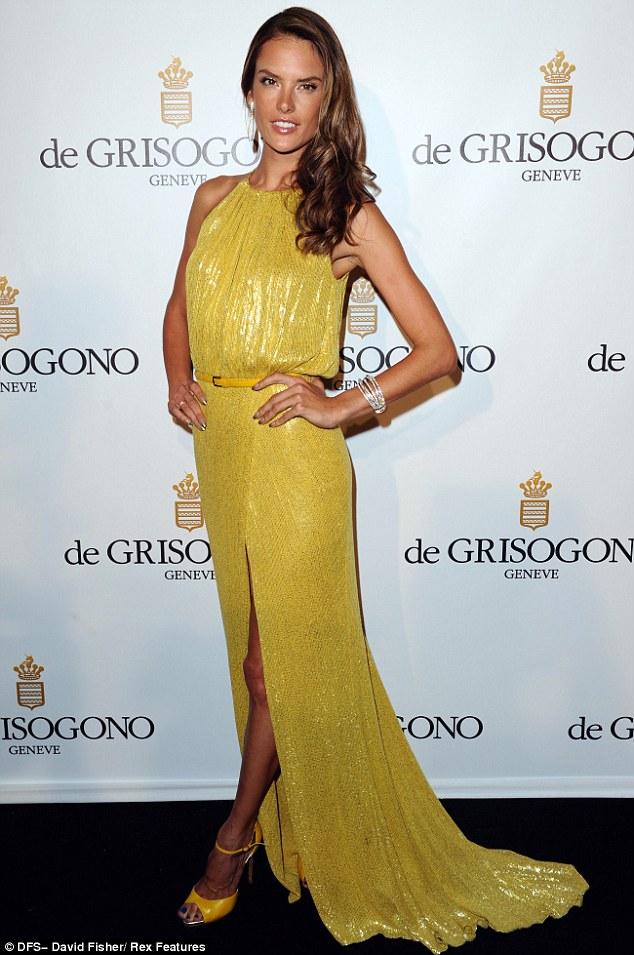 Alessandra Ambrosio shows off in gold!