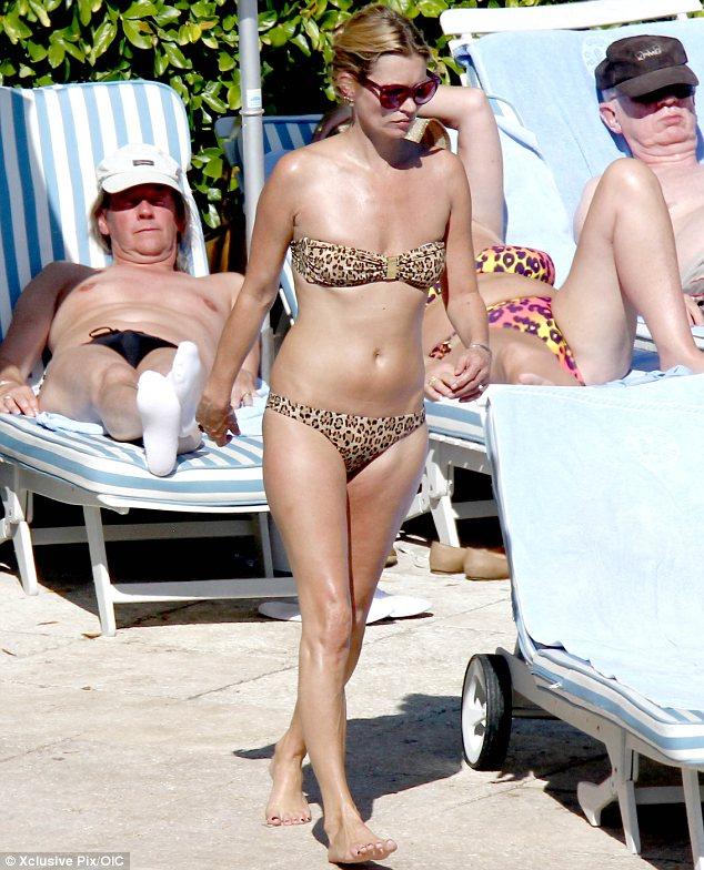 Kate Moss 'purrs' in leopard print swimwear