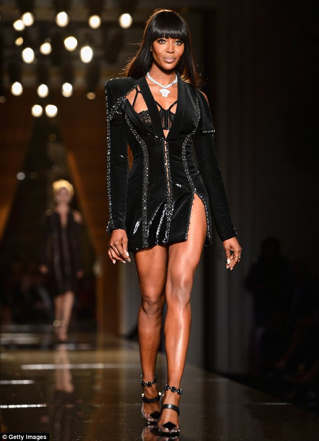 Naomi Campbell opens Versace fashion show and struts her stuff