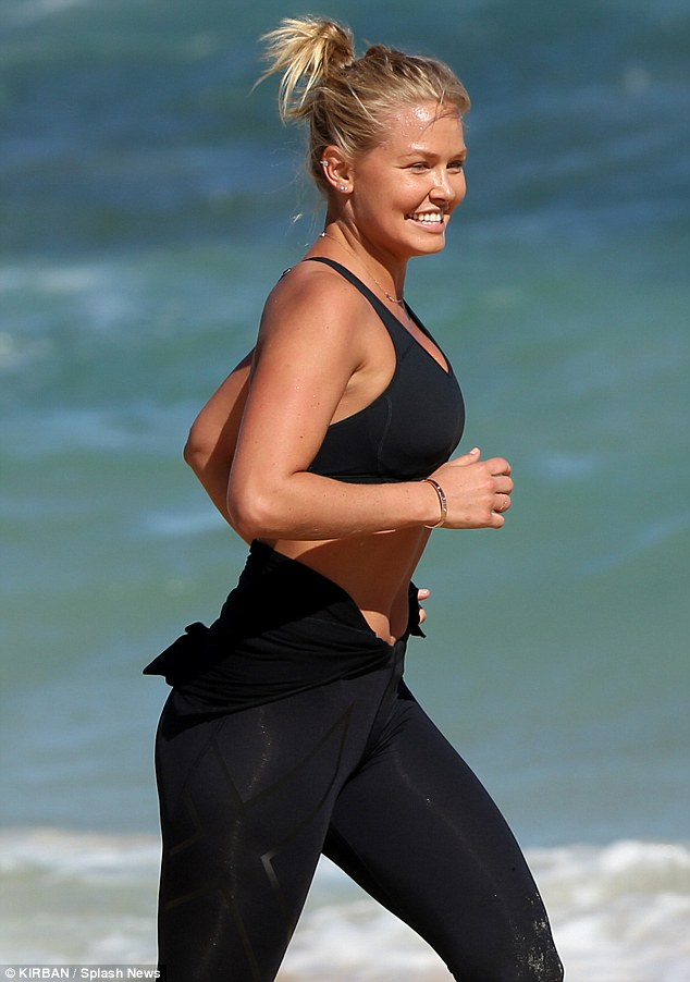 Lara Bingle shows how she keeps herself fit
