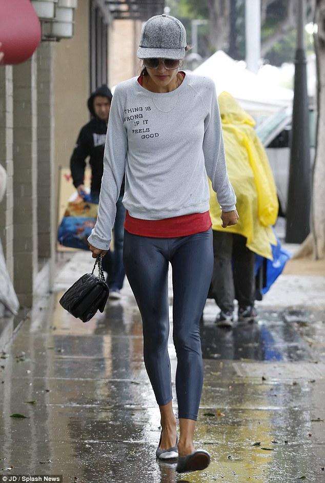 Alessandra Ambrosio struts her stuff come rain or sunshine!
