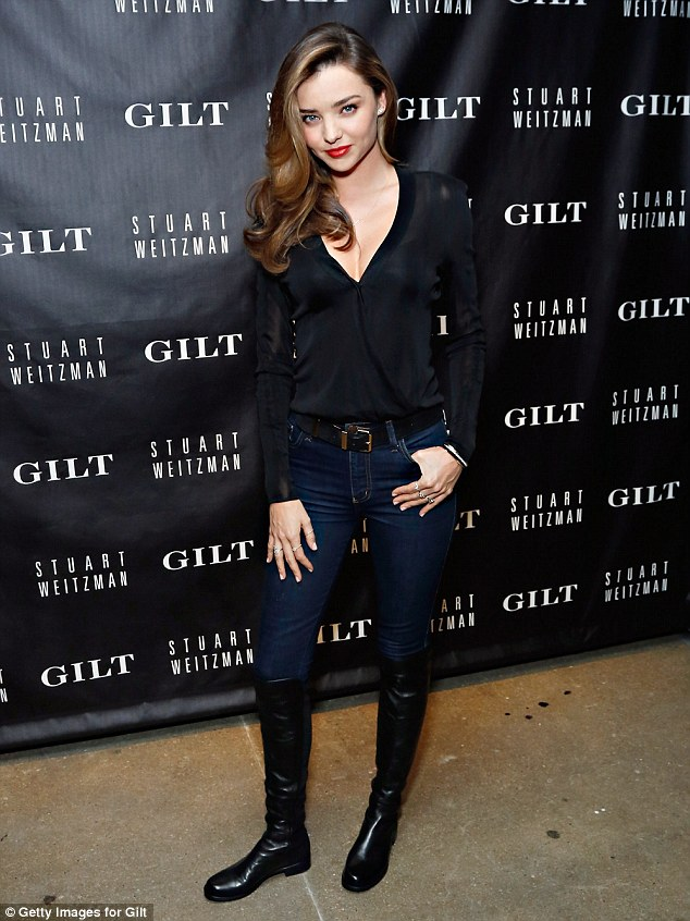 Miranda Kerr wears boots to Gilt and Stuart Weitzman event