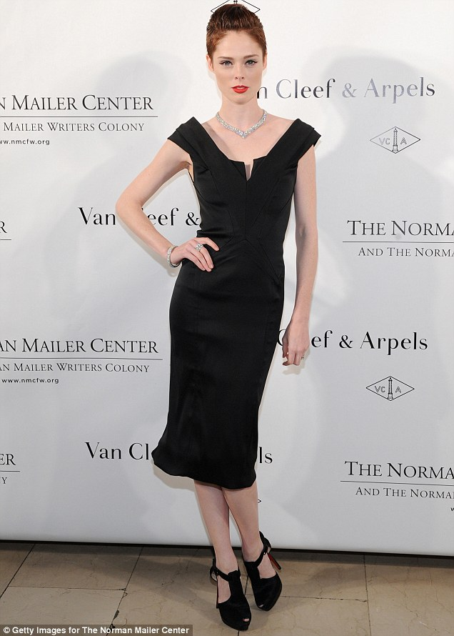 Coco Rocha lets the cropped hair and diamond necklace do all the talking!