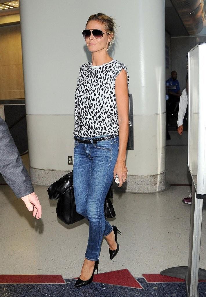 Heidi Klum rocks animal print as she jets in to LAX
