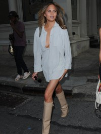 Chrissy Teigen risks wardrobe malfunction in bagg