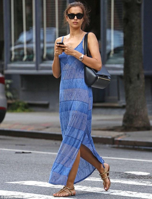 Irina Shayk stuns in striped maxi dress while running errands