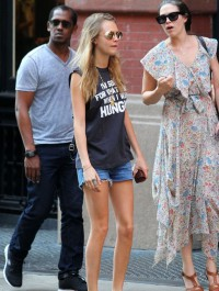 Cara Delevingne steps out in statement top and denim cut-offs