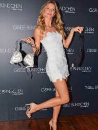 Gisele Bundchen promotes her lingerie brand in lacy white mini dress
