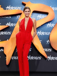 Irina Shayk smoulders in plunging red jumpsuit as she promotes Hercules film