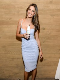 Alessandra Ambrosio stuns in form-fitting dress while promoting new beverage